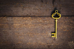 Old vintage key on wood texture background Royalty Free Stock Image