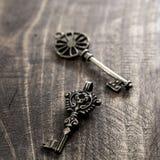Old vintage keys on rustic wooden background Royalty Free Stock Images