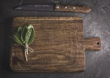 Old vintage kitchen cutting board and bunch with green sorrel le. Aves, top view Stock Image