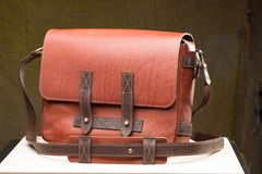 Old vintage leather bag with leather strap Stock Photos