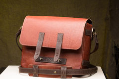 Old vintage leather bag with leather strap Royalty Free Stock Photos