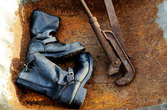Old vintage leather boots and rusty wrench Royalty Free Stock Photos