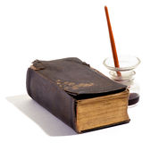 Old vintage leather bound book and inkwell Stock Image