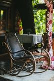 Old vintage leather rocking chair on the veranda royalty free stock photos