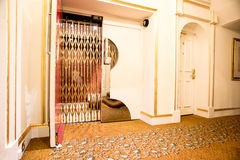 Old vintage lift at hotel lobby. Front view of a elevator with steel door in lobby Stock Photo