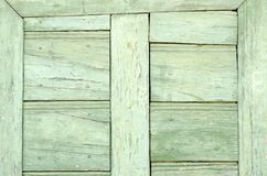Old vintage light green door detail. On earthy colored wall in a romanian village Royalty Free Stock Photo