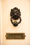 Old vintage lion head door knocker and letterbox. Valetta, Malta Stock Photography