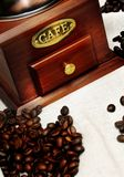 Old vintage manual coffee grinder with coffee beans royalty free stock image