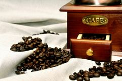 Old vintage manual coffee grinder with coffee beans royalty free stock photos
