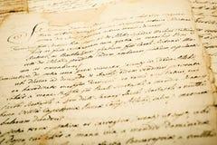 Old vintage manuscript. Writing in cursive Stock Images
