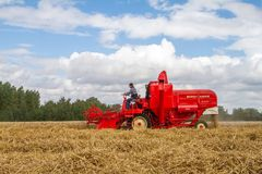 A old vintage Massey harris combine harvesters Stock Photos