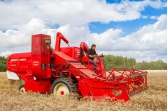 A old vintage Massey harris combine harvesters Stock Photography