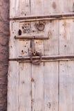 Old vintage massive wooden door with metal locker and handle Royalty Free Stock Image