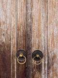 Old vintage metal door ring handle knocker Royalty Free Stock Images