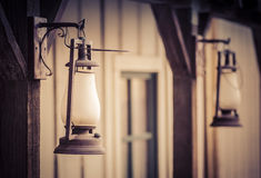 Old vintage metal oil lantern on wood wall Royalty Free Stock Images