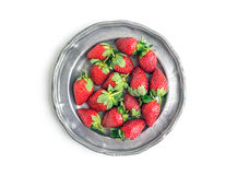 An old vintage metal plate full of fresh ripe strawberries over Stock Photos
