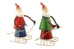 Old vintage metal Santa Claus figures on a sleigh Stock Images