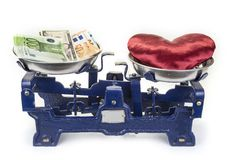 Old vintage metal scale with heart and money.Valentine`s Day concept. royalty free stock photography