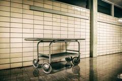 Old vintage metal stretcher in horror hospital Stock Photo