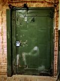 Old vintage metal warehouse door. Industrial metal warehouse door in a brick building. Great example of the old style heavy duty warehouse doors Royalty Free Stock Photo