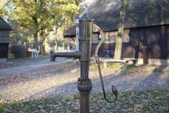 Old vintage metal water pump in the garden of a old village in the netherlands stock photos