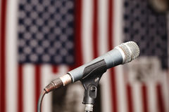Old vintage microphone on the background of the American flag. A Old vintage microphone on the background of the American flag Royalty Free Stock Image