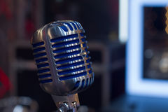 Old vintage microphone. Closeup old cool vintage steel blue microphone Stock Photography
