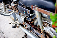 Old vintage motocycle in retro place Stock Images