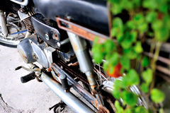 Old vintage motocycle in retro place Stock Photography
