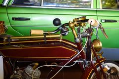 Old vintage motorcycle with horn and gold steering wheel. Old vintage motorcycle with horn and a gold steering wheel royalty free stock photo