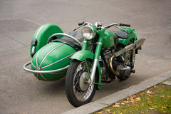 Old vintage motorcycle with sidecar. Parked in the street Royalty Free Stock Photo