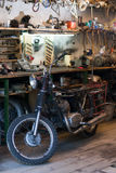 Old vintage motorcycle, which needs to be repaired, in the works Royalty Free Stock Photography