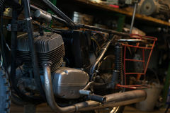 Old vintage motorcycle, which needs to be repaired, in the works Stock Photos