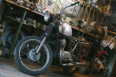Old vintage motorcycle, which needs to be repaired, in the works Royalty Free Stock Photos