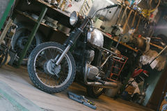 Old vintage motorcycle, which needs to be repaired, in the works royalty free stock images