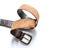 Old vintage natural leather belt on white Stock Photography