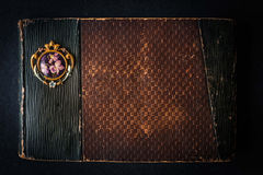 Old vintage notebook on the dark stone table Royalty Free Stock Photo