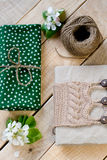 Old vintage notepad knitted in beige sweater, thick skein Stock Photo