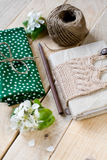 Old vintage notepad knitted in beige sweater, thick skein Stock Photos
