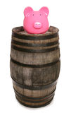 Old vintage oak wine barrel with piggy bank Royalty Free Stock Image