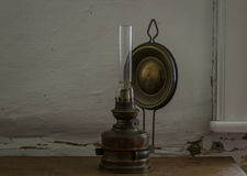 The old and vintage oil lamp on a wooden table Stock Images