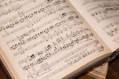 Old vintage opened musical book Stock Images