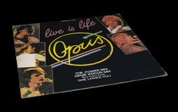 Old Vintage Opus life is life Album. `Live Is Life` is a song originally recorded in 1984 by Austrian group Opus. Isolated on a black background with path stock photo