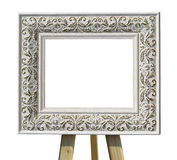 Old vintage ornate white picture frame on a stand with pattern i Stock Images