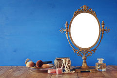 Old vintage oval mirror and woman toilet fashion objects Royalty Free Stock Image