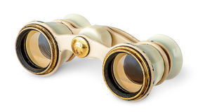 Old vintage pair of opera glasses in opposite directions Stock Image