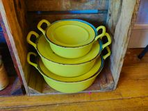 Vintage yellow pans used as decoration stock image