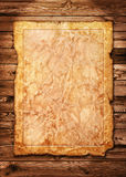Old Vintage Paper with Torn Edge. On Brown Wood Planks as Natural Background Stock Image