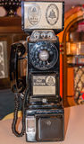 An old vintage pay phone. An old vintage pay black telephone Royalty Free Stock Photography