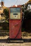 Old vintage petrol pump. Old red derelict petrol pump, no logo stock images